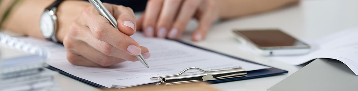 Close up of woman filling out a form